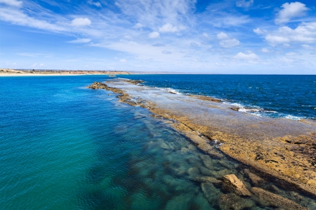 breakwaters: natural breakwaters in Port Noarlunga during the day  Port Noarlunga,  South Australia, Australia
