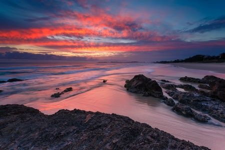 australian seascape at sunrise with rich in red color cloud formation (currumbin beach,queensland,australia) photo