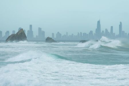 qld: Currumbin rock with Gold Coast City as background (Gold Coast, Currumbin, QLD, Australia)