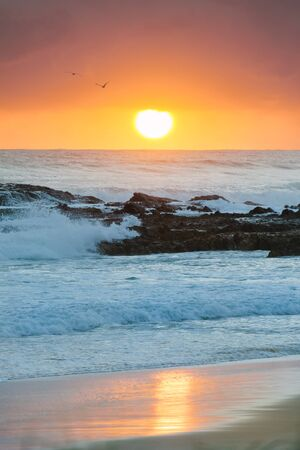 qld: Sunrise at flat rock (Gold Coast, Currumbin Beach, QLD, Australia)