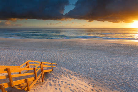 qld: Australian beach entry with stairs in foreground at sunrise (Gold Coast, Mermaid Beach, QLD, Australia)