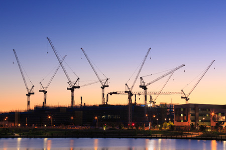 water's: Many cranes at Australian construction site (Sunshine Coast, Kawana Waters, QLD, Australia) Stock Photo