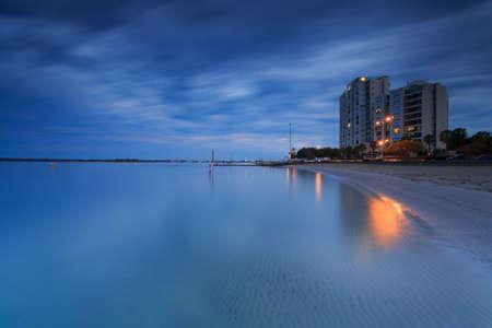 gold coast australia: Australian suburb in front of water at night (Gold Coast, Labrador, QLD, Australia)