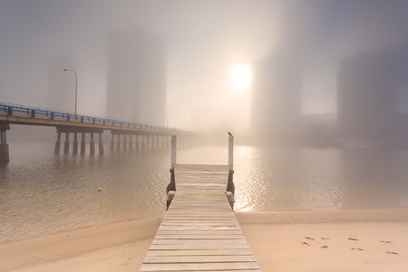 qld: Foggy morning in the centre of big modern Australian city (Gold Coast, Surfers Paradise, QLD, Australia)