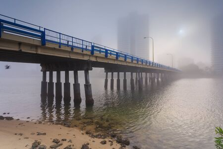 surfers: Foggy morning in the centre of big modern Australian city (Gold Coast, Surfers Paradise, QLD, Australia)