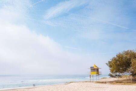 qld: Foggy morning on Australian beach (Gold Coast, Broadbeach, QLD, Australia)