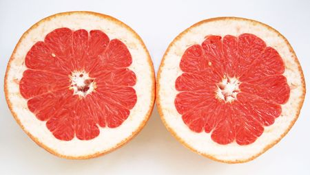 Grapefruit halves close-up isolated on the white background photo