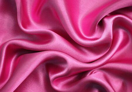 滑らかなエレガントなピンクのシルクの背景として使用することができます。