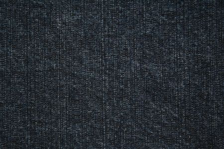 worn structure: dark blue jeans can use as background