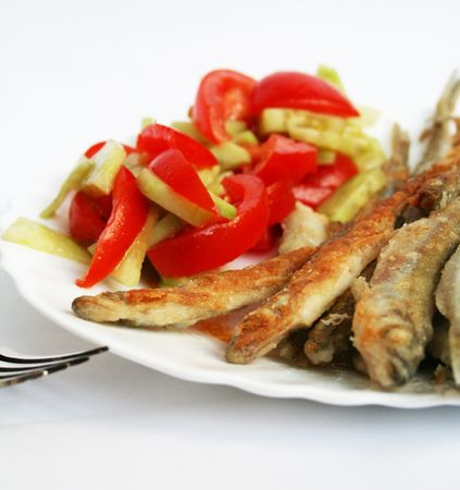 smelt: Traditional Russian fish -smelt in flour crust appetizer with salad on the plate