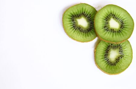 Green kiwi slices isolated on white can use as background photo