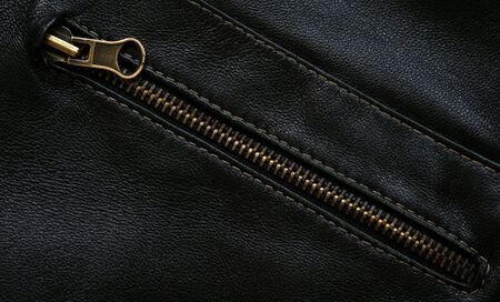 Zipper on the black leather texture can use as background photo
