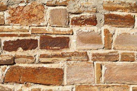 Abstract old colorful stone wall can use as background  photo