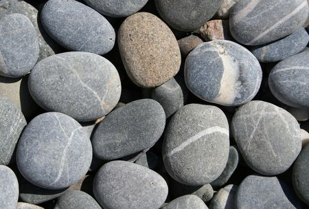 Grey pebbles on the beach can use as background  photo