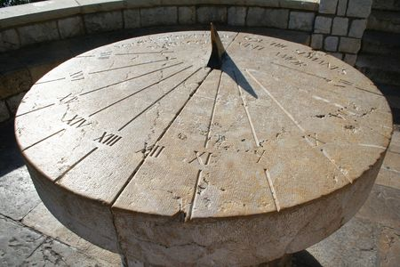 Spain. Tarragona. Ancient sundial on a Stone platform  photo