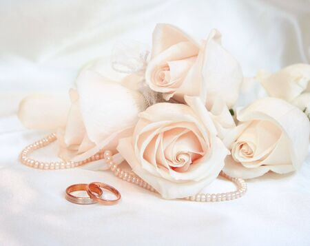 Wedding rings and roses as wedding background