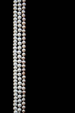 White and pink pearls on the black silk as background Stock Photo - 6359067