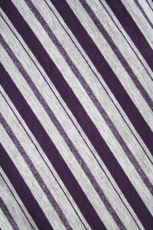 Grey and lilac strips on the fabric can use as background  photo