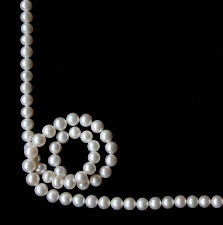 velvet background: White pearls on the black velvet background