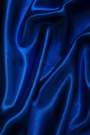Smooth elegant dark blue silk as background photo