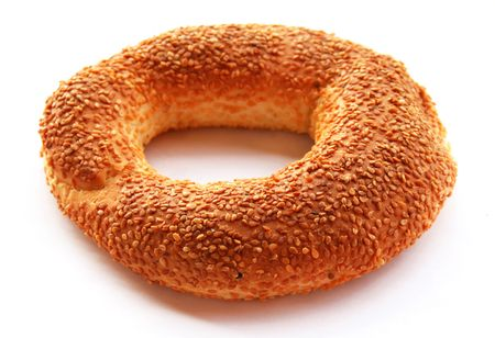 The Turkish bagel strewed by sesame seeds on white background  Imagens