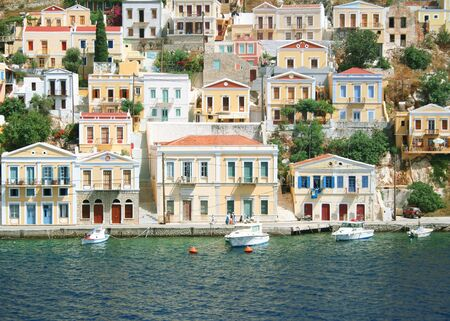 Greece. Dodecanesse. Island Symi (Simi). Colorful houses Stock Photo - 8082584