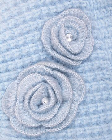 Blue wool flowers on blue wool knitted background Stockfoto
