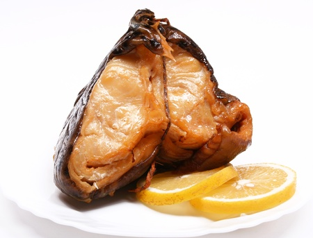 Smoke-cured catfish with lemon on white plate Stock Photo - 8409167