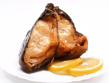 shark catfish: Smoke-cured catfish with lemon on white plate Stock Photo