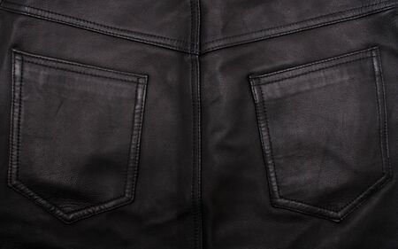 Pockets on the black leather texture can use as background  photo