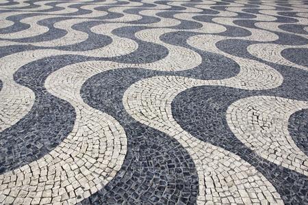 Portugal. Lisbon. Typical portuguese cobblestone hand-made pavement photo