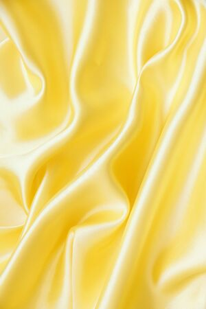 Smooth elegant golden silk can use as background  Stock Photo