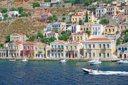 Greece. Dodecanesse. Island Symi (Simi). Colorful houses  photo
