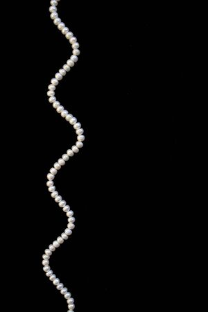White pearls on the black silk as background Stock Photo - 9663020