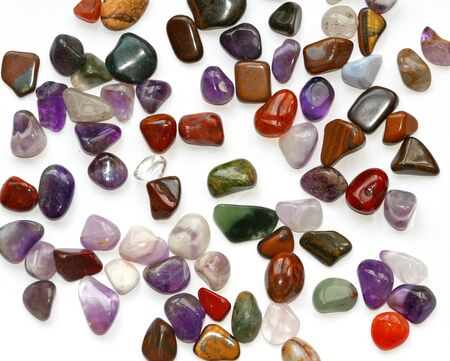 Colorful semiprecious stones on white background photo