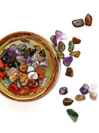 Colorful semiprecious stones on white background photo