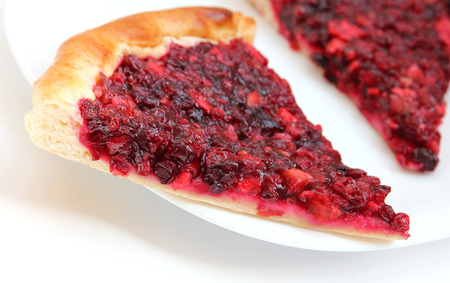 cowberry: Piece of apple and cowberry jelly pie on the white plate