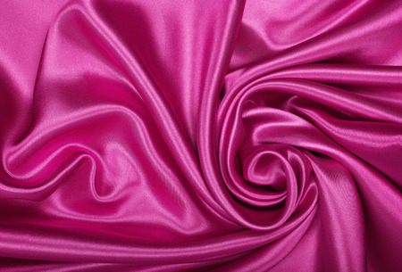 Smooth elegant pink silk or satin can use as background photo