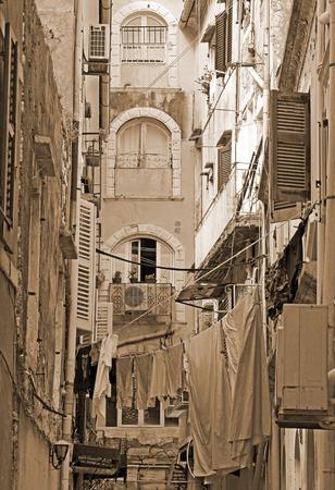 kerkyra: Greece. Corfu (Kerkyra) island. A typical courtyard in the center of Corfu Town.  In Sepia toned. Retro style