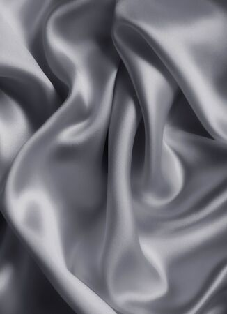 Smooth elegant grey silk or satin texture can use as background photo