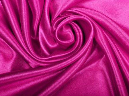 Smooth elegant pink silk or satin texture can use as background photo