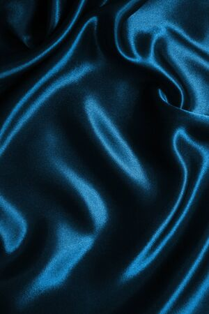 satiny: Smooth elegant blue silk or satin can use as background