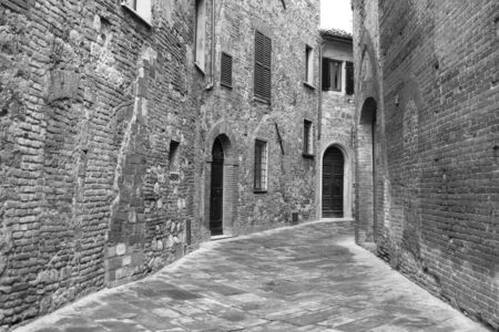 montepulciano: Italy. Tuscany region. Montepulciano town. Medieval street. In  in black and white toned. Retro style