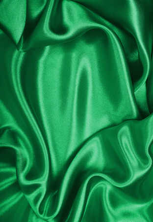Smooth elegant green silk or satin texture can use as background Standard-Bild