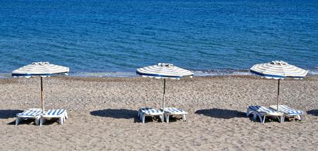 kos: Greece. Kos island. Chairs and umbrellas on the Kefalos beach
