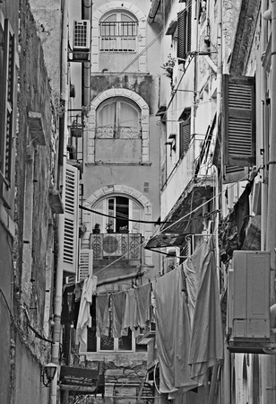 kerkyra: Greece. Corfu (Kerkyra) island. A typical courtyard in the center of Corfu Town. In black and white