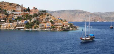 Greece. Aegean sea. Island Symi (Simi). Mandraki harbor. In blur style
