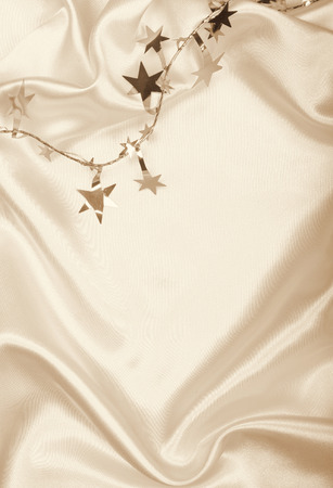 spangles: Golden stars and spangles on silk can use as background. In Sepia toned. Retro style