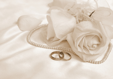 gold ring: Wedding rings and roses as background Stock Photo
