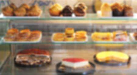 showwindow: Portugal. Porto city. Traditional portugal cakes on  show-window. In blur style